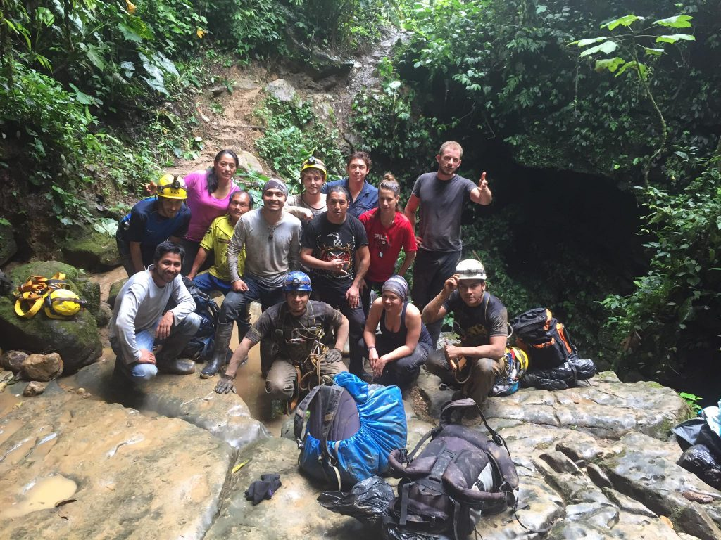 Group in front of cave