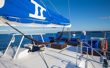 Relax on the sun deck of Nemo II while cruising between the islands