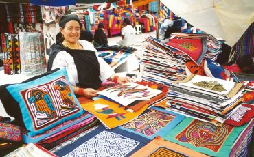 You visit Otavalo with its famous colorful market.