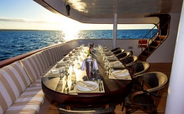 Enjoy you meals in the open air ding area of Odyssey catamaran.