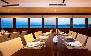 Enjoy your meals in the dining area of the Catamaran Odyssey