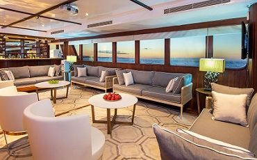 Relax in the lounge of the Catamaran Odyssey