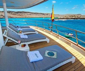 Relax on the shaded terasse of Odyssey Catamaran