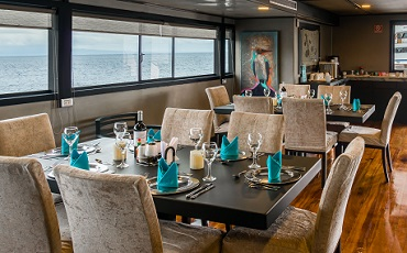 Enjoy your meals in the luxury dining area of the Seastar Journey