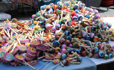 On the market of Otavalo you can find colorful toys.