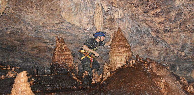 Explore the Cueva de los Tayos
