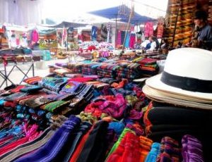 Discover treasures on the colorful market of Otavalo.