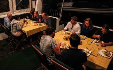 Enjoy your meals in the cozy eating area of the ctamaran Nemo II