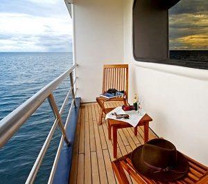 Enjoz views over the sea from the balcony of the Ocaen Spray yacht