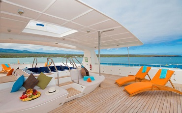 Relax on the sun deck oft the yacht Cormorant.